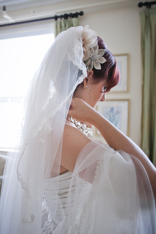 Bride Putting on Necklace